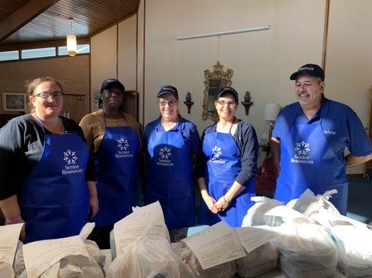 Volunteers bagging meals