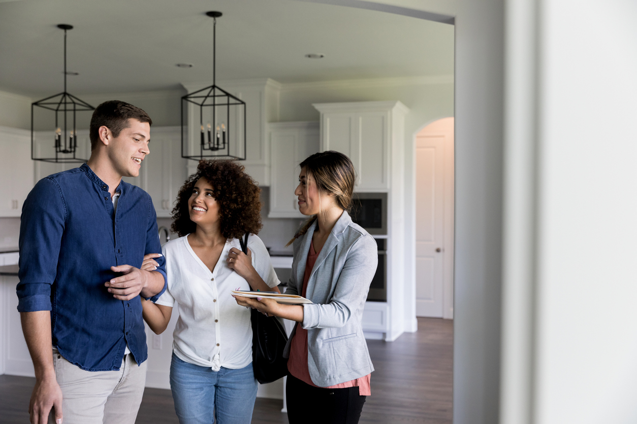 Couple touring home with real estate agent
